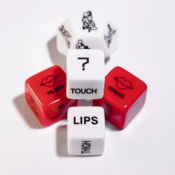 Playing cubes of red and white color for sexual games